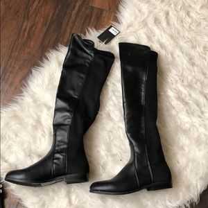 Black over the knee boots.